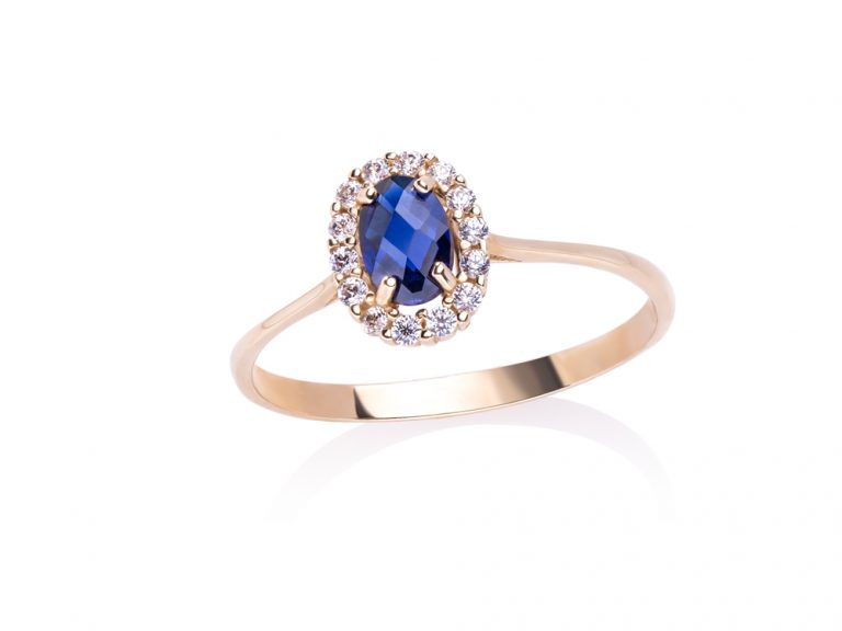 Classic yellow gold ring with white and blue zircons
